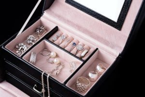 Jewelry box with white gold and silver rings